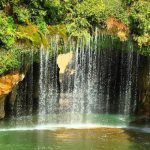 Semirom, Semirom waterfall, a waterfall with green area, a city with waterfall, waterfall, water springs, water and stone.